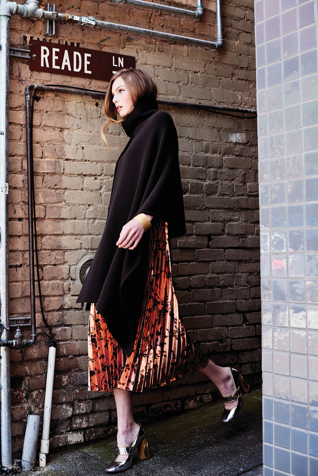 Pleated lamé dress, $995; reversible poncho, $1,195, both by TSE at TSE